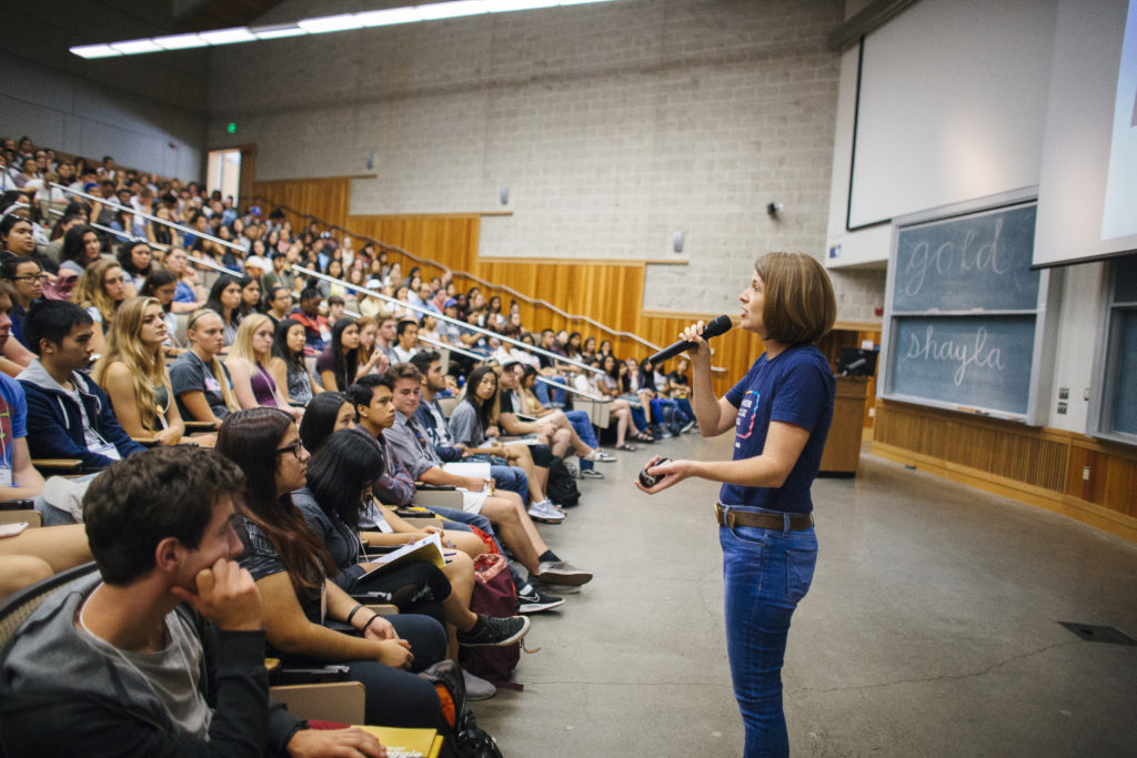 Woman speaker addressing a classroom full of students